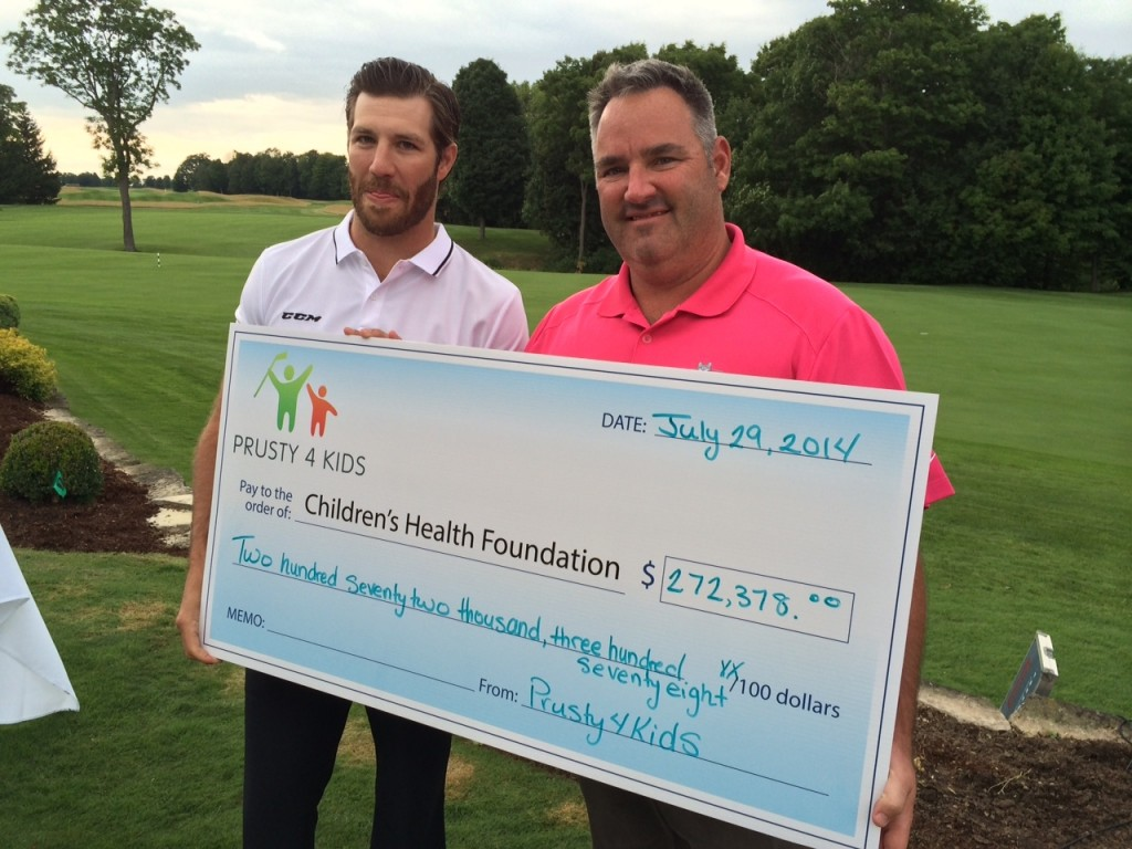 Brandon and Dave holding giant cheque
